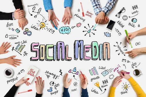 People group works at a table - Social Media Concept